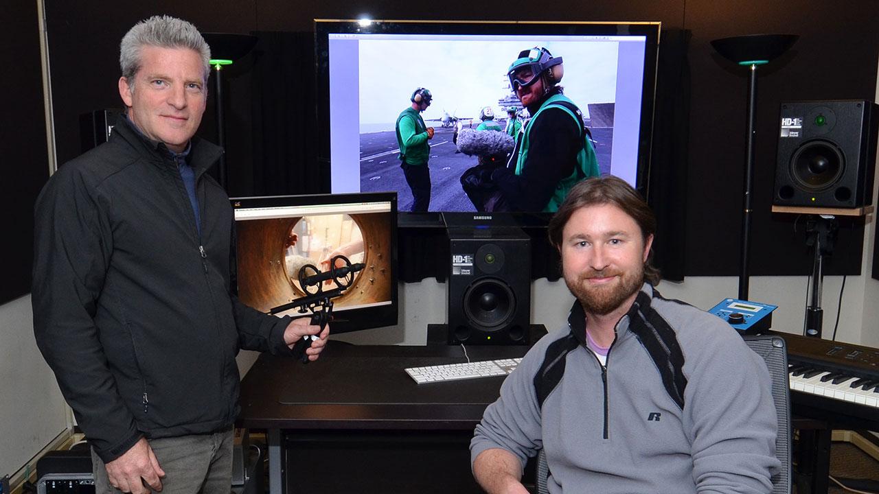 Ethan Van der Ryn holding the Sanken CO-100K microphone and Erik Aadahl