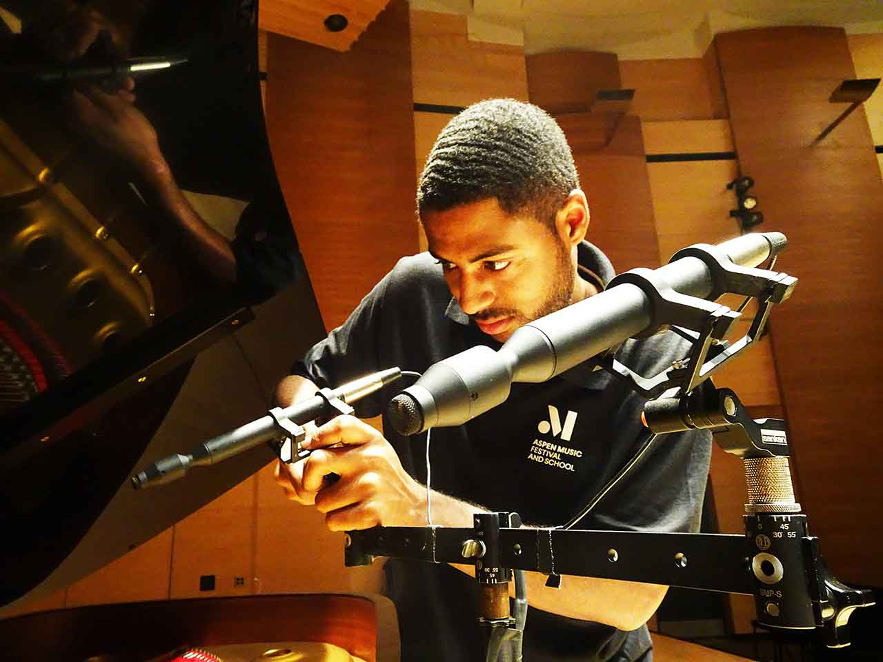 Johnathan Smith miking a grand piano with a pair of Sanken CO-100K microphones
